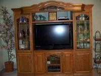 Solid Oak Entertainment Center. Unit is 87 inches wide,