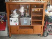 entertainment center $40.00, antique table w/ 2 chairs