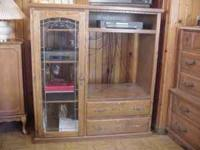 $150 or best offer. This sold oak entertainment center