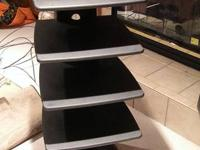 Selling a Black entertainment center stand.  Good for