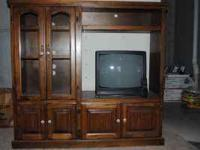 Dark Stained Oak Entertainment Center with a 19 inch