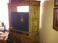 I have a rustic style entertainment center and matching