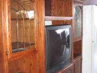 Nice wood entertainment center with 37inch TV. Great