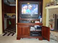 "Entertainment Center with a 35"" Tv, the old models , in"