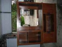 Wood entertainment stand with glass door. In great
