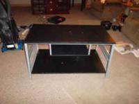 TV Stand. Will hold TV and other electronic equipment.