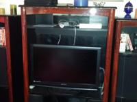 Type: Living Room Fits 32 tv might fit a 40. Has