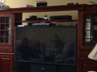 Large cherry entertainment center excluding the tv with