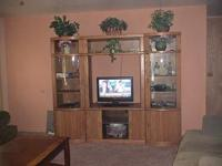 Beautiful solid oak entertainment center.. Moving and i