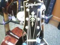 Check it out! 1937 Arch Top Guitar Triumph model In