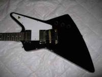 This is a black electric guitar in great shape. About 1