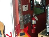 Very Nice Epiphone Bass Les Paul style In great shape.