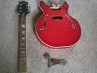 This is an early 70's Epiphone hollowbody guitar. These