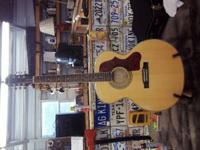 EPIPHONE EJ-200 ARTIST NEW. PAID $450.00 LAST YEAR