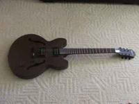 Two Epiphone Guitars for sale: 1) Black SG-310.