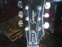 It come's with a Esteban Guitar Amplifier with cord,
