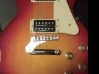 I am selling my Epiphone Les Paul 100 Cherry Sunburst.