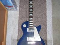 I am selling my blue plus top Epiphone Les Paul. This