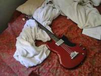 Junior size. Only has 3 strings. Knobs a little loose.