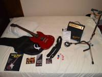 I am selling my fresh Epiphone Special SG red electric