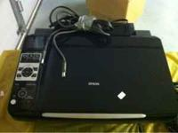 Epson printer/scanner/copier.works great, needs heads