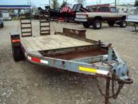 This is a 14' skid steer or equipment trailer. It has a