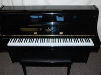 ESSEX (BY STEINWAY) CONSOLE PIANO, 2009 The Essex piano