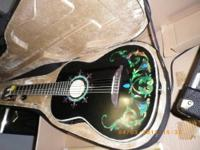 "Here is a new Estaban ""Duende"" Inlaid Classical Guitar"