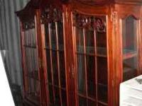 We have a beautiful hand carved china cabinet that must