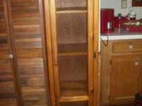 In an estate sale is this lovely like new pine cabinet