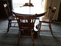 Kitchen table & chairs. $100.00. Shelving. $25.00.