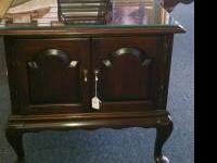 Here is an Ethan Allen end table. It has a cherry
