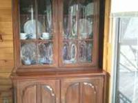 Very nice hutch in a medium dark color . Dishes and