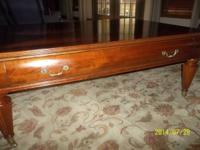 This Ethan Allen Coffee table measures 50 X 36 is in