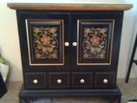This is a ethan allen curious cabinet it is in perfect