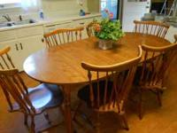 Ethan Allen dining table and 6 chairs. Has an