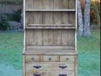 This antiqued pine Ethan Allen Old Tavern China Hutch