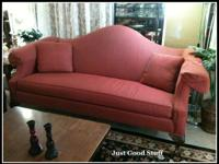 This sofa is classic style camelback.  Comes with two