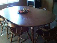 i am selling our ethan allen table and 6 chairs, its