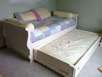 We have an Ethan Allen Twin Trundle Sleigh Bed for