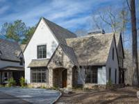 This European style new construction home in the Swann