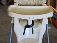 A NICE EVENFLO JUVENILE HIGH CHAIR. IN GOOD USED