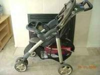 Black and tan Evenflo Aura stroller. Canapy with