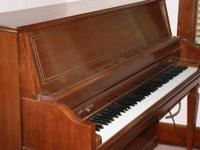 Everett Upright Piano with bench. Excellent quality.