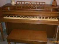 """Everett"" spinet piano, $850. Maple finish."