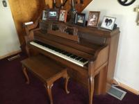 Everett Upright Piano and Bench - Good Condition. We