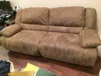 Selling a sofa recliner made by Ashley that is