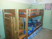 Twin over twin wooden bunk beds with stairs for sale.