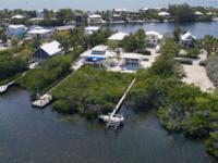 This truly unique property with 151' of Bayfront in