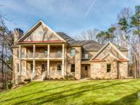 This is it! Brick and stacked stone new construction on